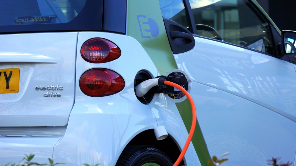 Electric car plugged in and recharging